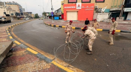 Soldiers with barbed wire in Baghdad