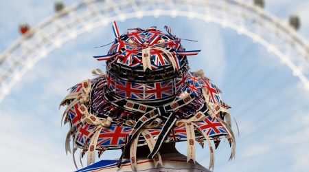 Person with union jacks on hat